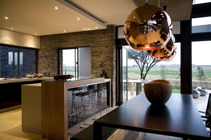 Luxurious interior in dark colors and stone walls