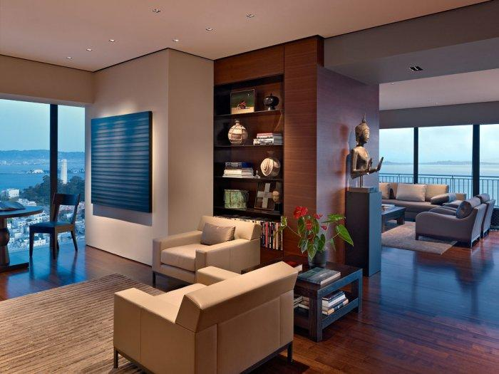 Luxurious living room in a high-rise apartment with amazing views over the city