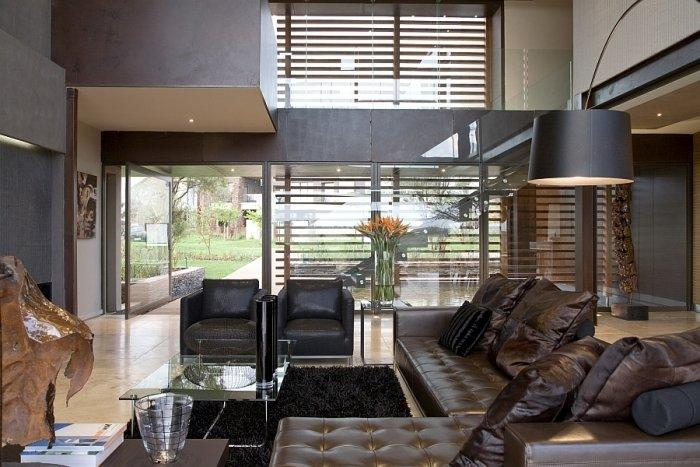Luxurious living room with leader sofa and pillows in dark brown