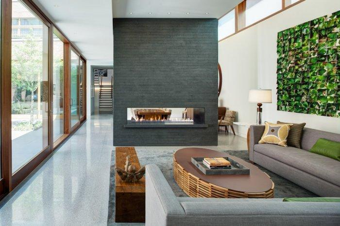 Luxurious living room with stylish modern bio fireplace in grey