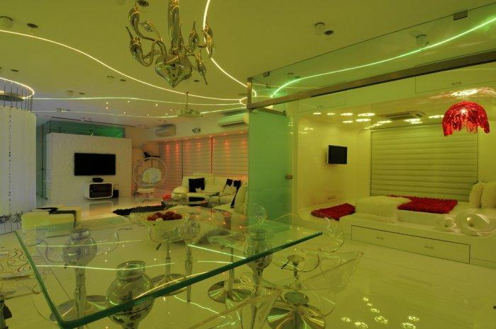 Luxurious open plan room with creative LED illumination