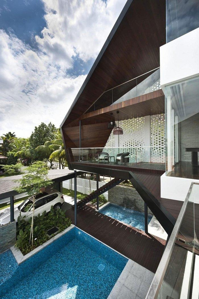 Luxurious residence and a view from the second floor towards the pool and garage
