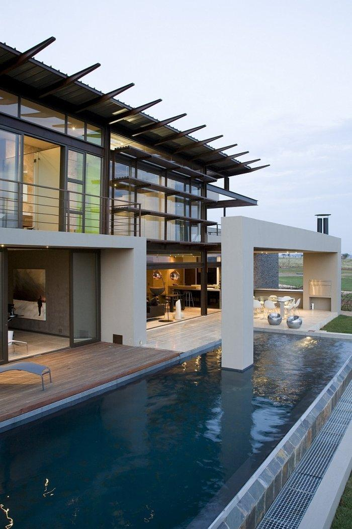 Luxurious two storey house with outdoor pool and interesting facade