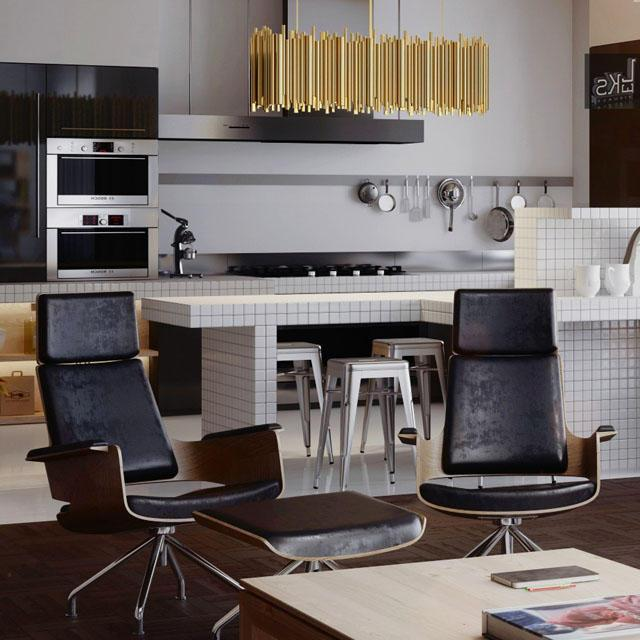 Mid-century modern black chairs and modern white kitchen behind them