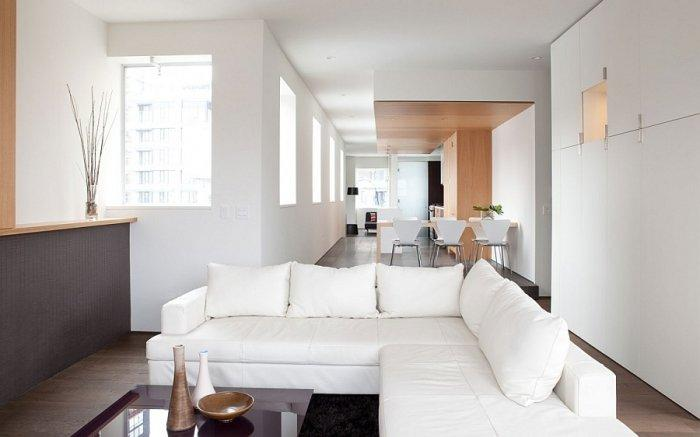 Modern apartment with spacious living room with white furniture