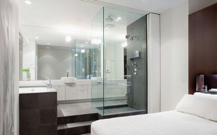 Modern bedroom in white with minimalist bathroom attached to it