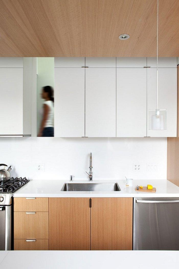 Modern kitchen design with simple and elegant lines in white and brown