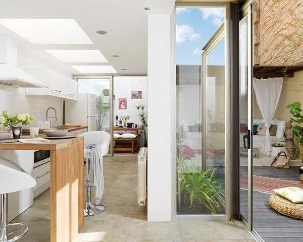 Modern kitchen with open plan design expanding to outside areas