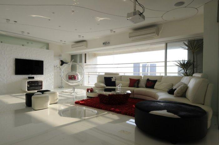 Modern living room in white with futuristic accents in the interior