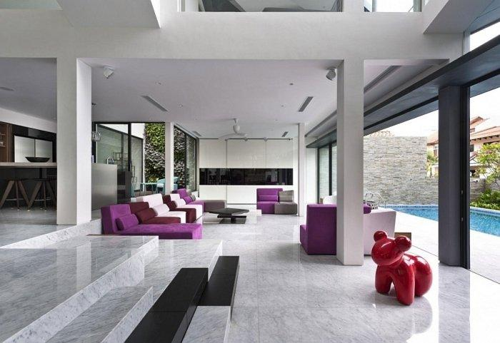 Modern living room with glass sliding doors leading to the pool