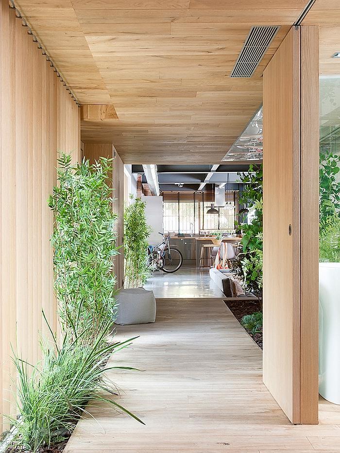 Modern loft with outdoor hallway leading inside