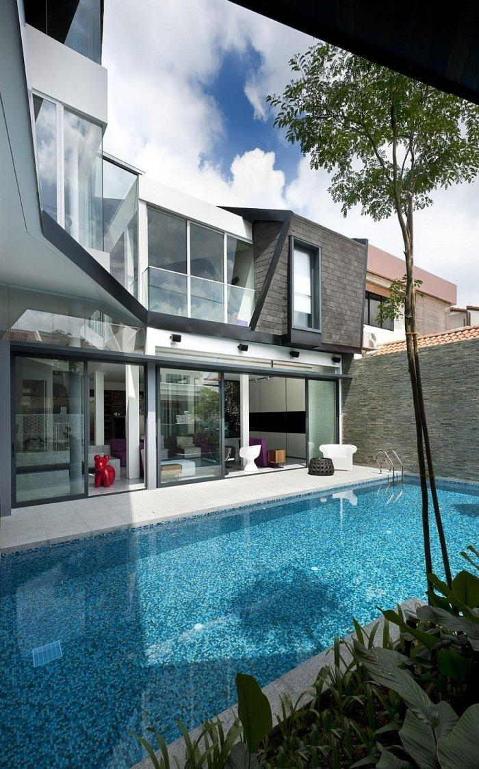 Modern pool placed outside the luxurious residence in the yard