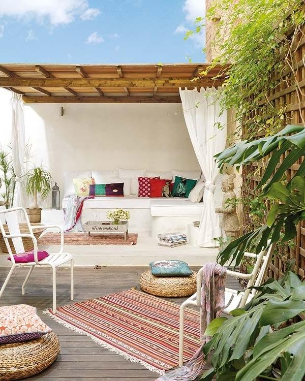 Modern terrace with comfortable furniture and colorful pillows for decoration