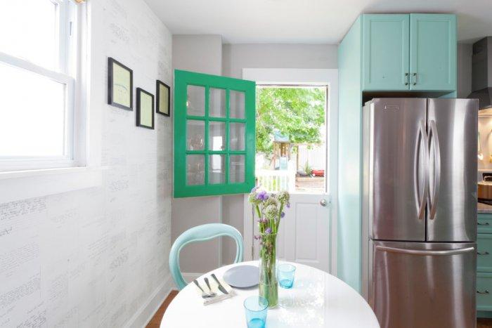Open kitchen with cyan accents and door leading outside