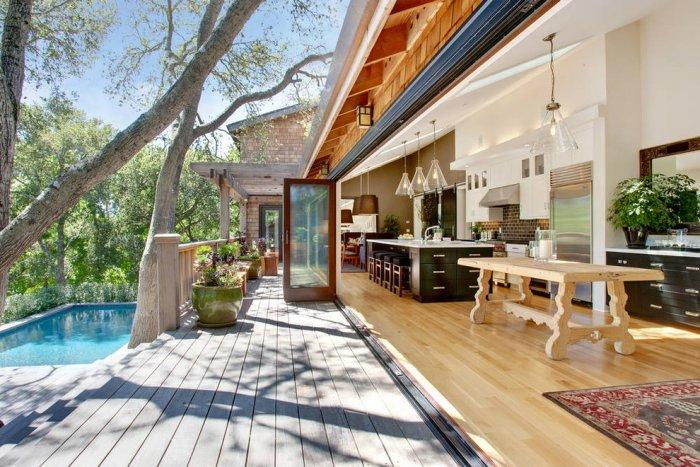 Open kitchen with spacious terrace and wooden deck outside
