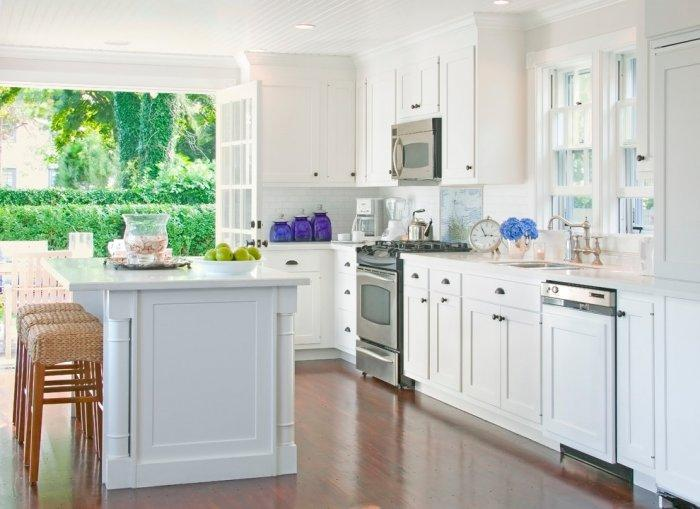 Open kitchen with white cabinets and island