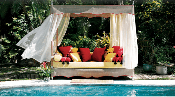 Outdoor canopy gazebo near a swimming pool with blue waters