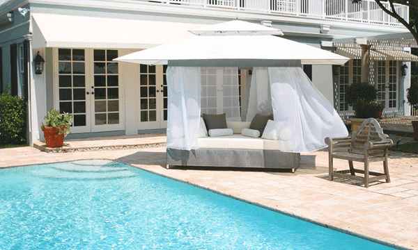 Outdoor canopy gazebo outside a luxury house with swimming pool