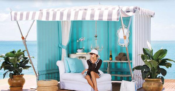 Outdoor canopy gazebo with couch for relaxation and striped tent
