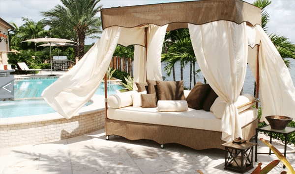 Outdoor canopy gazebo with floating white curtains and comfortable cushions