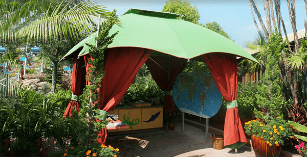 Outdoor canopy gazebo with green awning and red sides