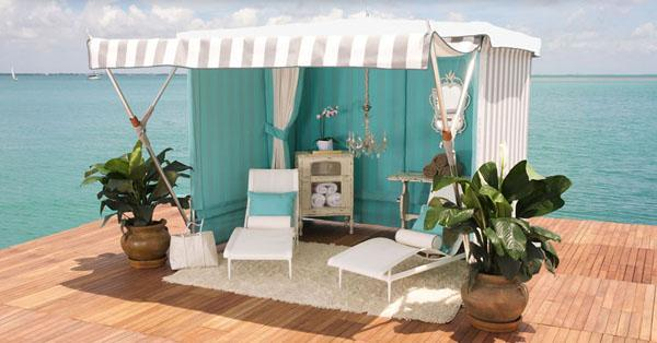 Outdoor canopy gazebo with two lounge chairs and green flowers