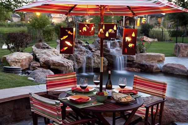Outdoor dining are with small table near the pond