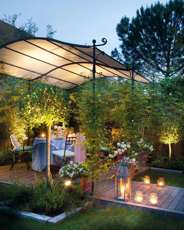 Outdoor dining area that is set for a romantic evening under the stars