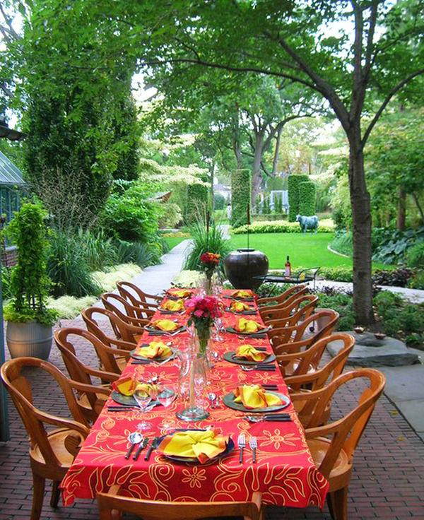 Outdoor dining area with long table and a lot of chairs