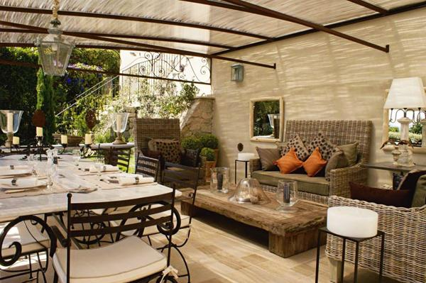 Outdoor dining room with two tables - one for dining and one for coffee