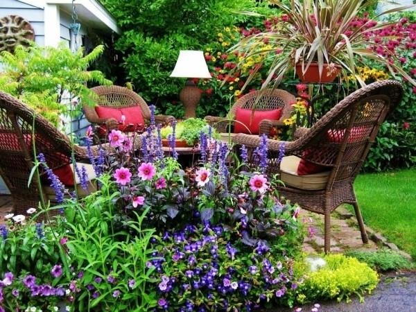 Outdoor dining set for four among the beautiful surrounding nature and flowers