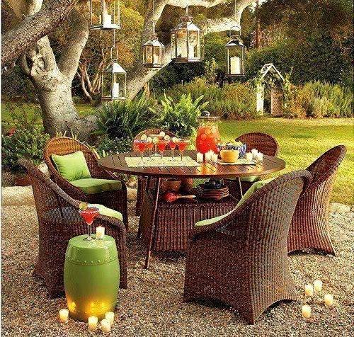 Outdoor dining set of round table and rattan chairs