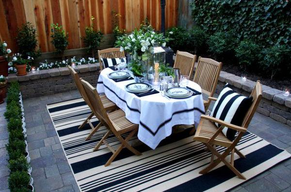 Outdoor dining table placed in an inner courtyard in a house