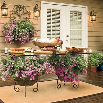 Outdoor dining table placed on the veranda and prepared with meals