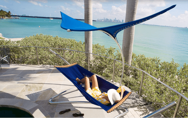 Outdoor hammock with creative modern shelter in blue