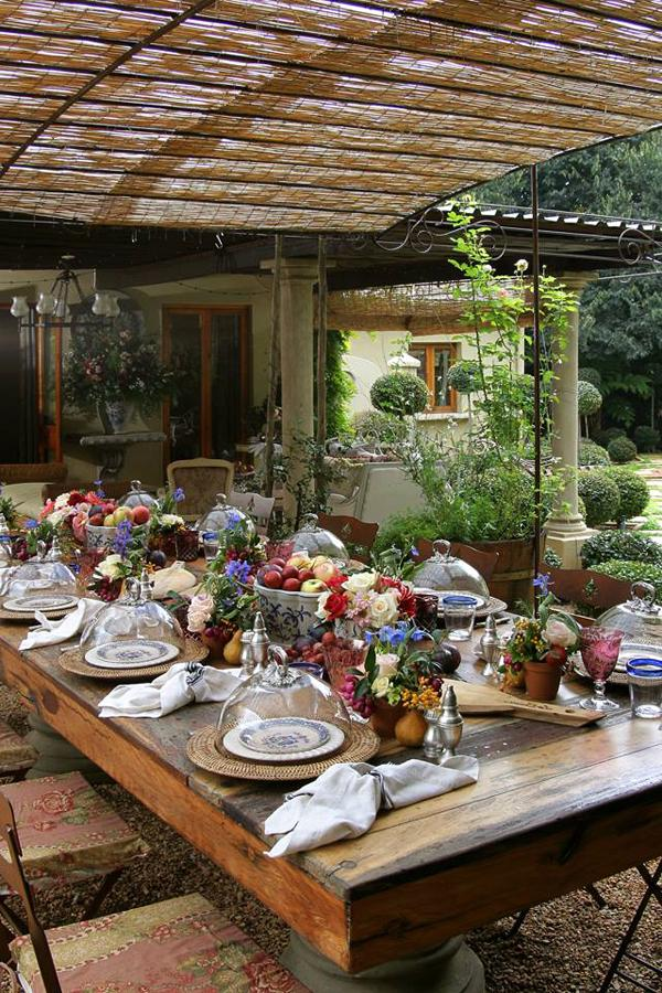Outdoor rustic table under a wide pergola made of wood