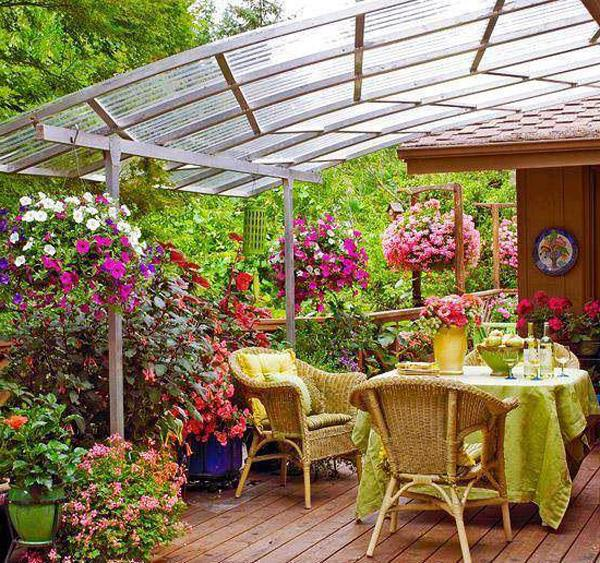 Outdoor table with chairs under a veranda shelter