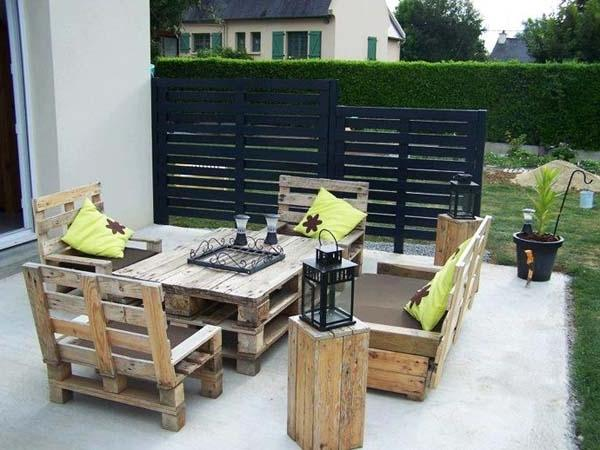 Pallet furniture used as a set of armchairs and table for outdoor use
