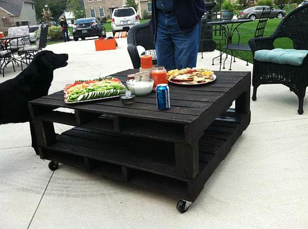 Pallet furniture used as a stylish mobile coffee table for outdoor use