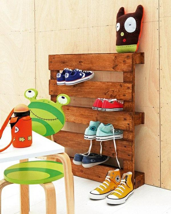 Pallet furniture used as shoe rack in the hallway