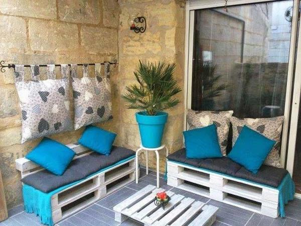 Pallet Furniture Used As Sofas And Small Coffee Table