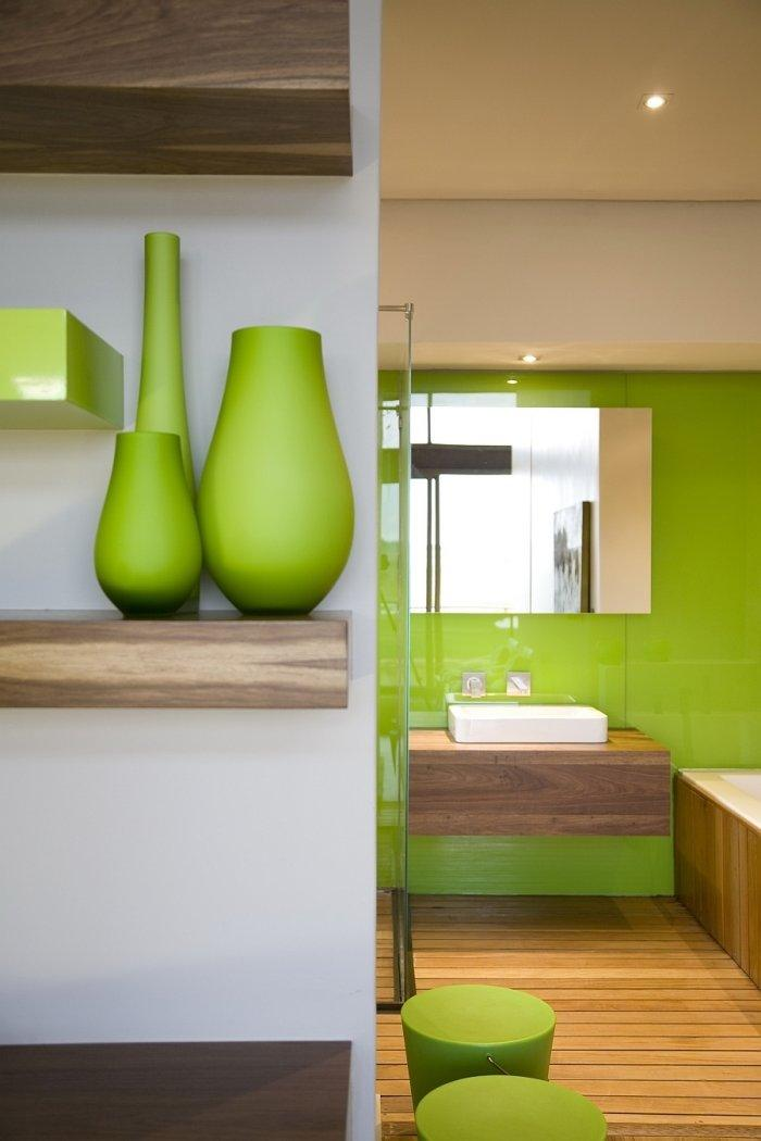 Private bathroom with fresh green interior and decorations