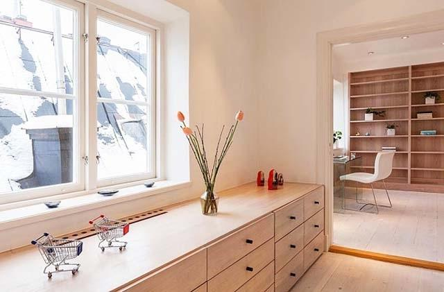 Scandinavian chest of drawers in white color and various simple decorations