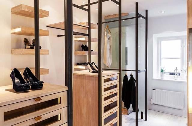 Scandinavian clothes storage room with wooden shelves for shoes and clothes