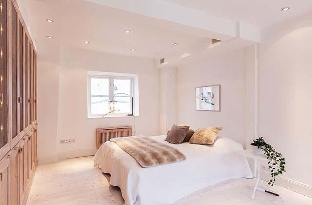 Scandinavian white bedroom with simple, elegant and functional design