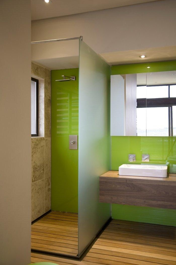 Small green bathroom with separated shower cabin