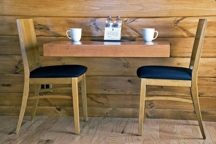 Small wooden table with two chairs perfect for morning coffee