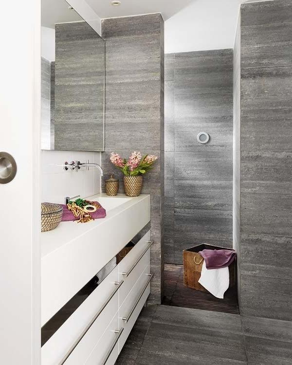 Stylish bathroom with white vanity and small decorative flowers