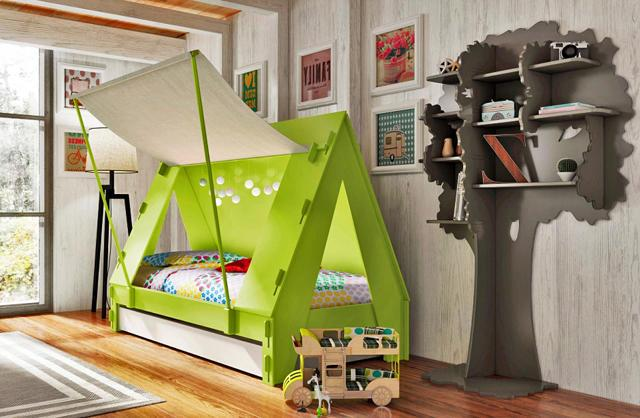 Tent caravana in green color placed in a kids room