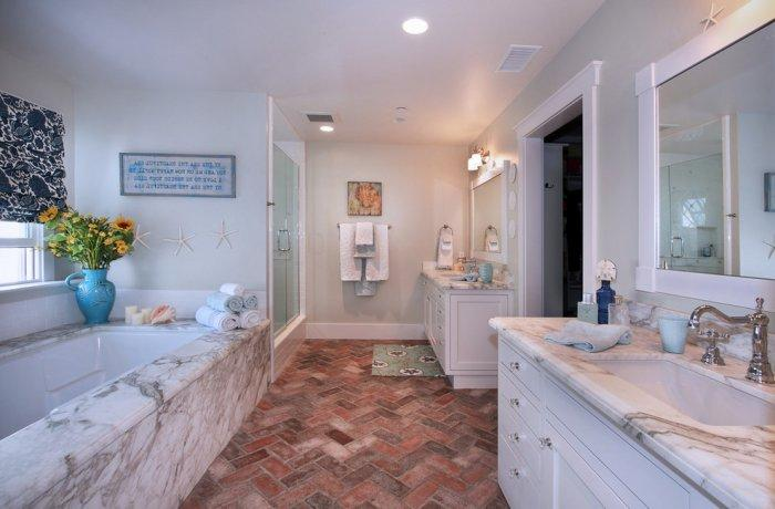 Traditional bathroom interior with marble faucet and bathtub